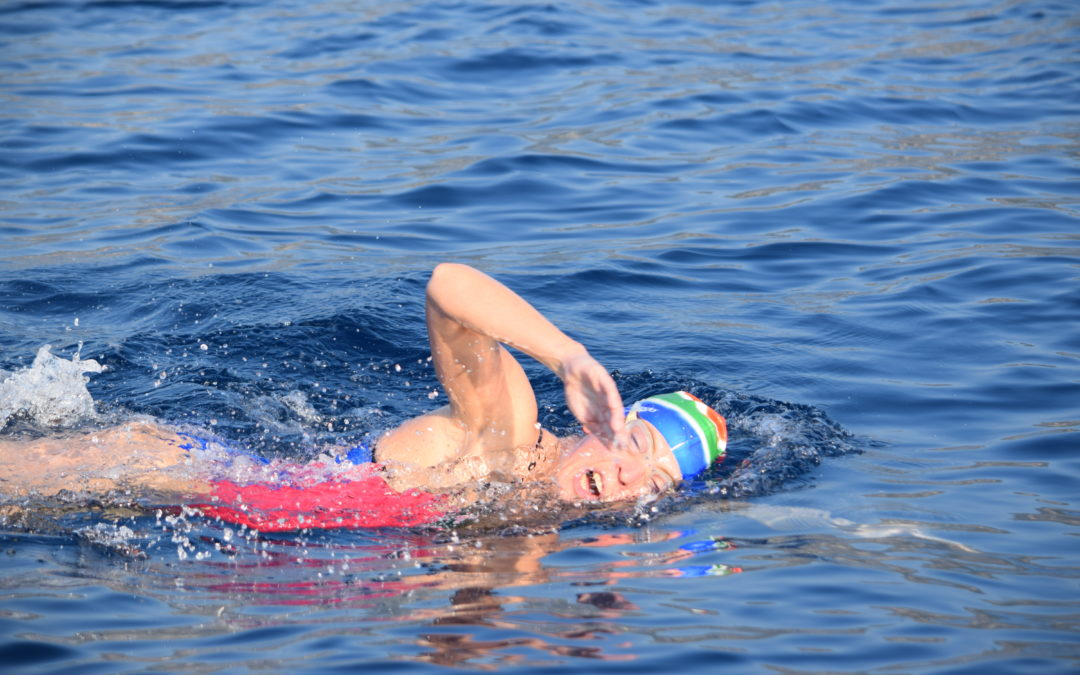 Carina completes epic 21km swim spanning 3 European countries, in support of Muzukidz