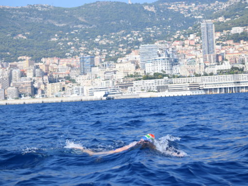 Carina completes epic 21km triple country swim