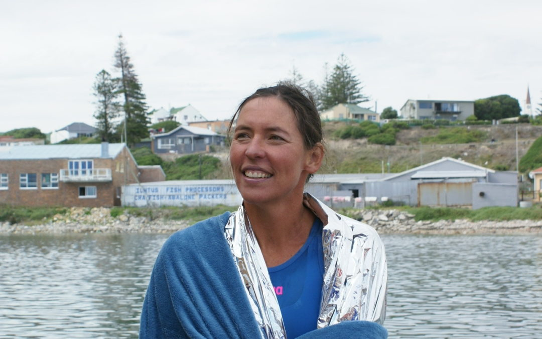 Carina Bruwer completes momentous and world-first 21km open water swim in aid of the arts and the Tribuo fund